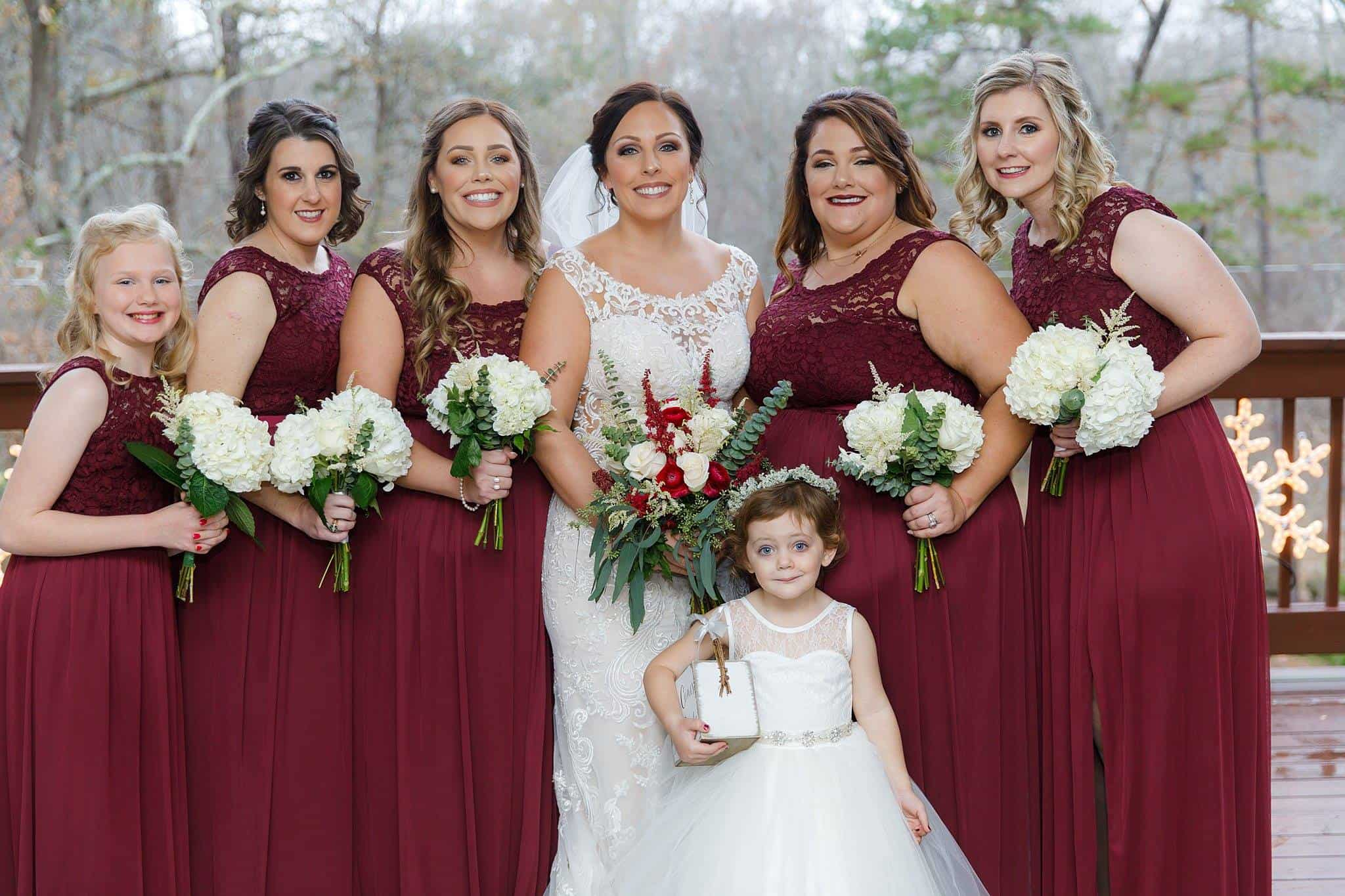 Bride in Lace Gown with Bridesmaids in Red Lace bridesmaids dresses