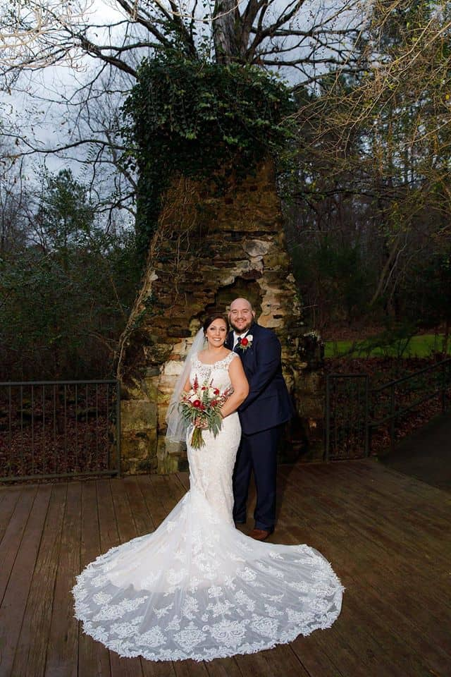 Bride and Groom in front of chimney with bridal train