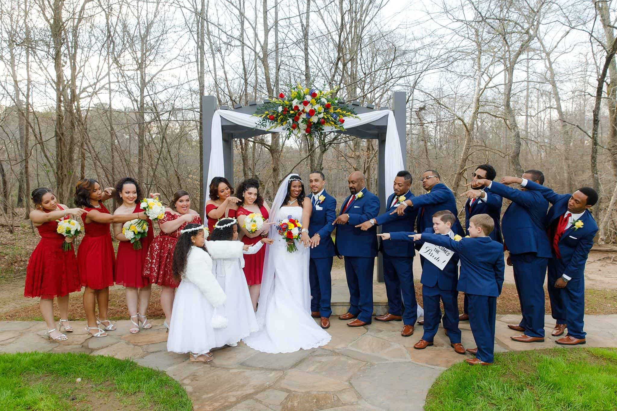 Bride and Groom with Bridesmaids, Groomsmen, ring bearers and flowergirls in wedding ceremony photo at the altar with river in the background