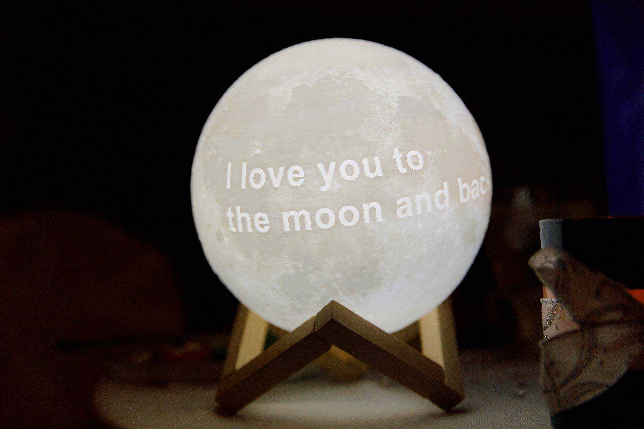 Lit Globe with Saying I Love you to the Moon and Back at Wedding Reception
