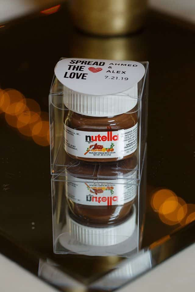 Wedding Favor that is a jar of Nutella with the message Spread the Love in a clear package