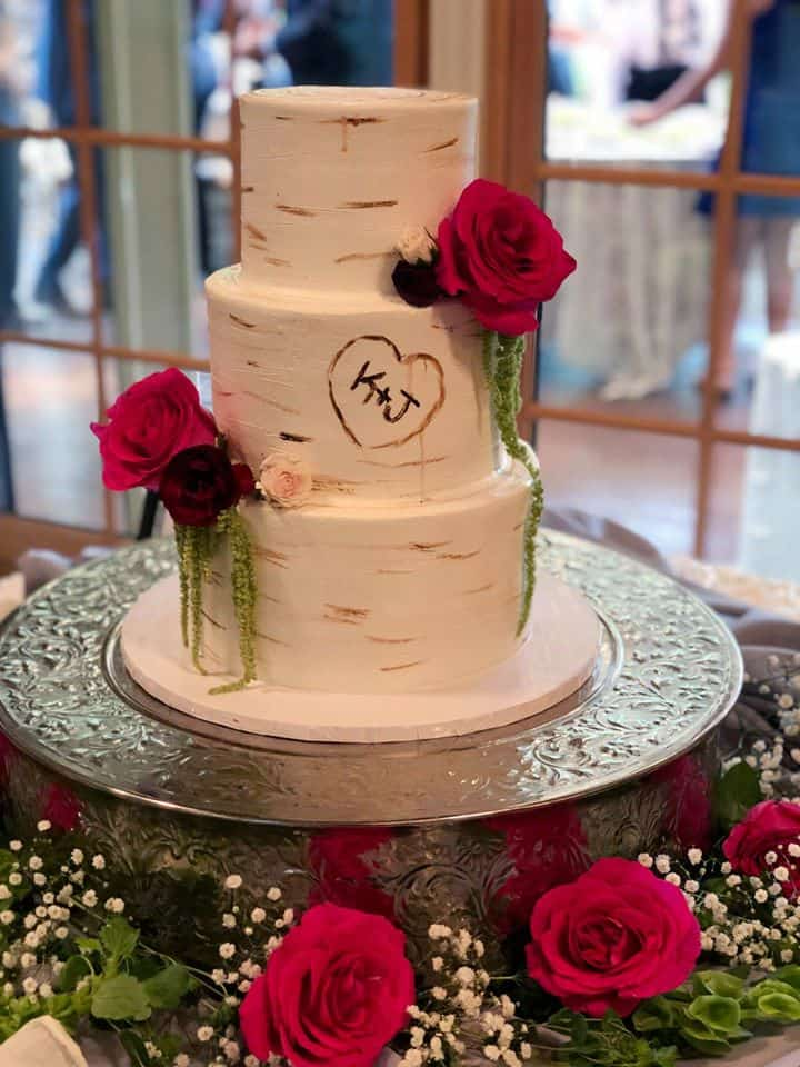 Naked Rustic Wedding Cake with Three Tiers Decorated with Red Roses and Green Amaranthus