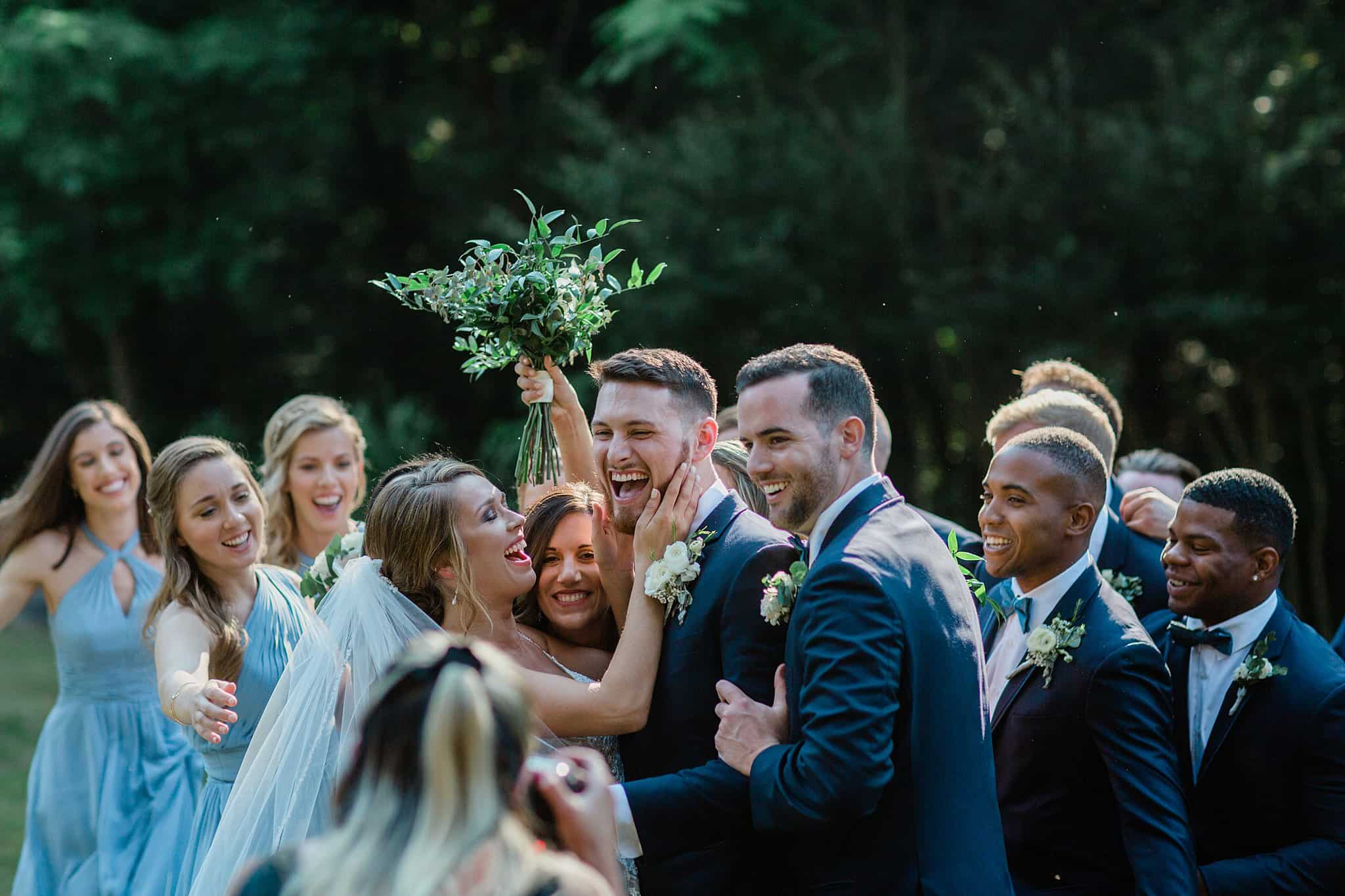 Bride and Groom with Bridal party smiling