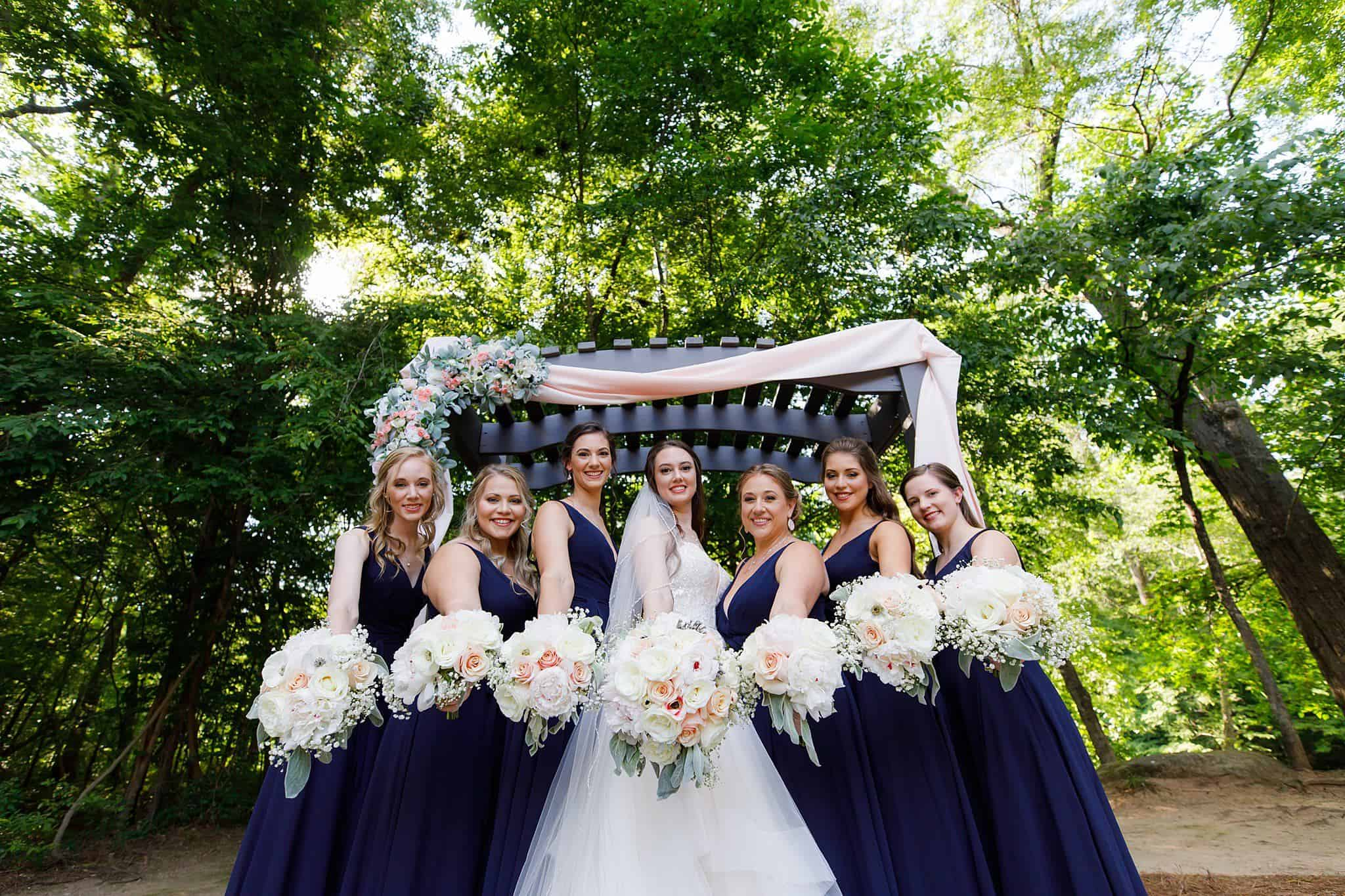 Bride and bridesmaids show off bouquets
