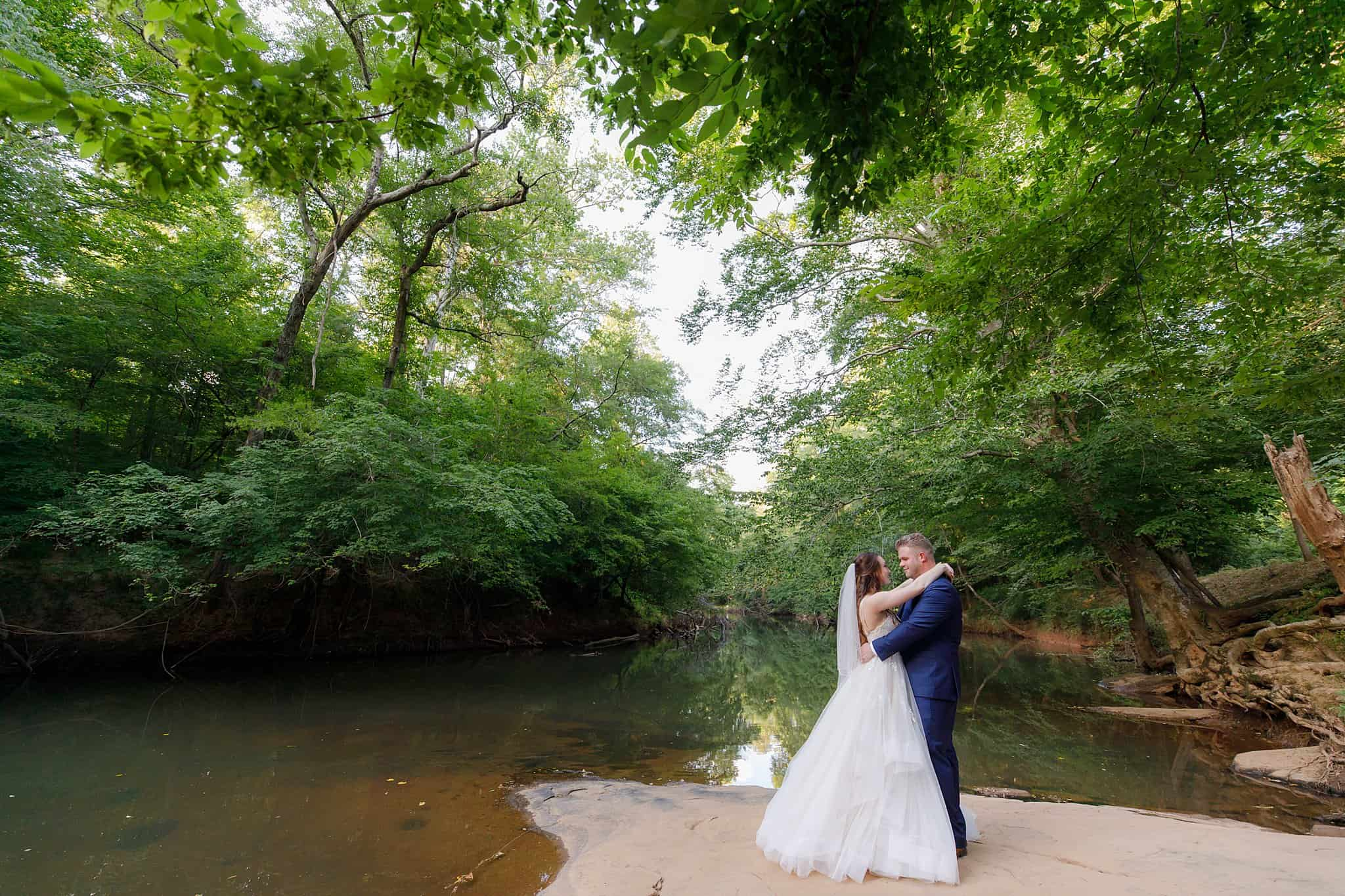 Bride and Groom on river's edge