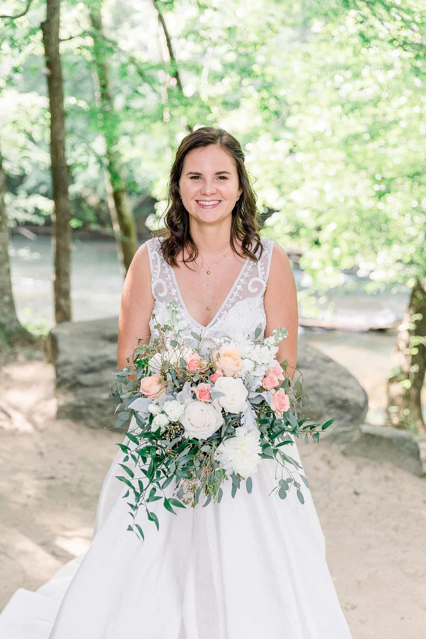 Bride with blush floral arrangement