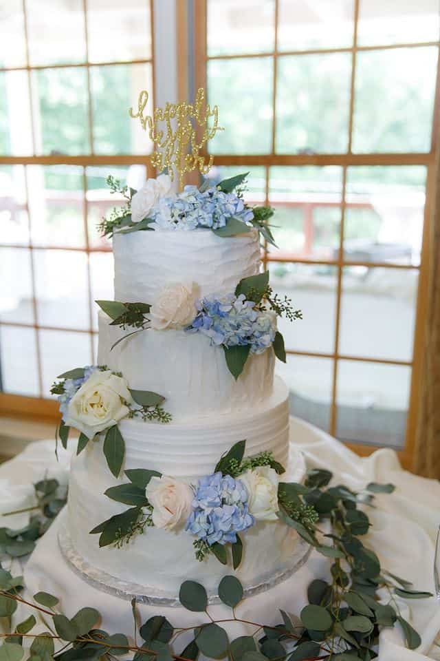 Wedding Cake with Four Tiers Decorated with Hydrangeas