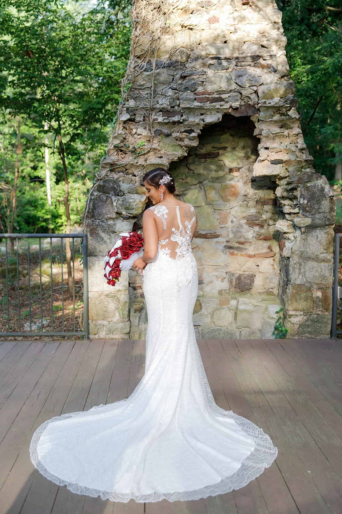 bride showing off illusion-back gown