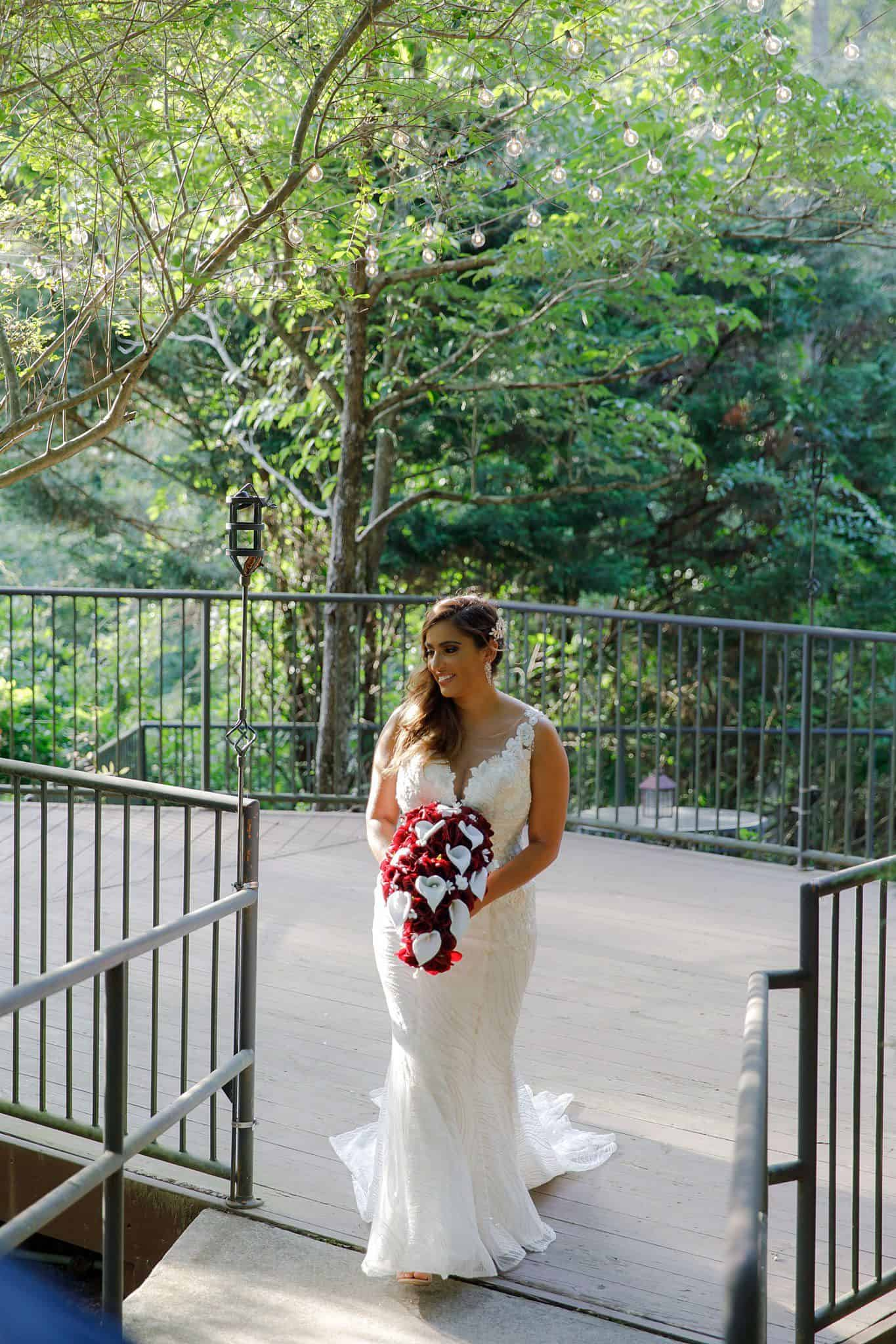 bride poses on secluded patio