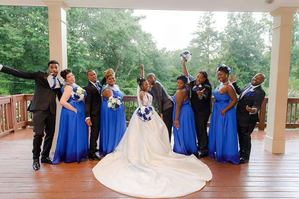Bride with Groom and Bridal party on deck posing during wedding reception