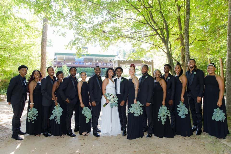 Bridal party with Bride and Groom outside posing in black