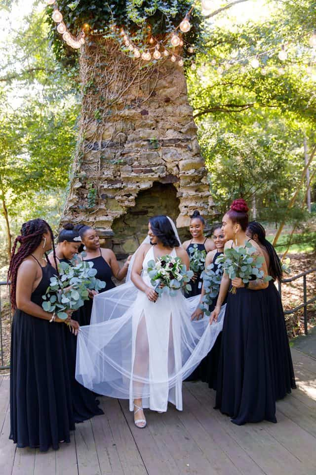 Bride with Bridesmaids in front of outdoor chimney