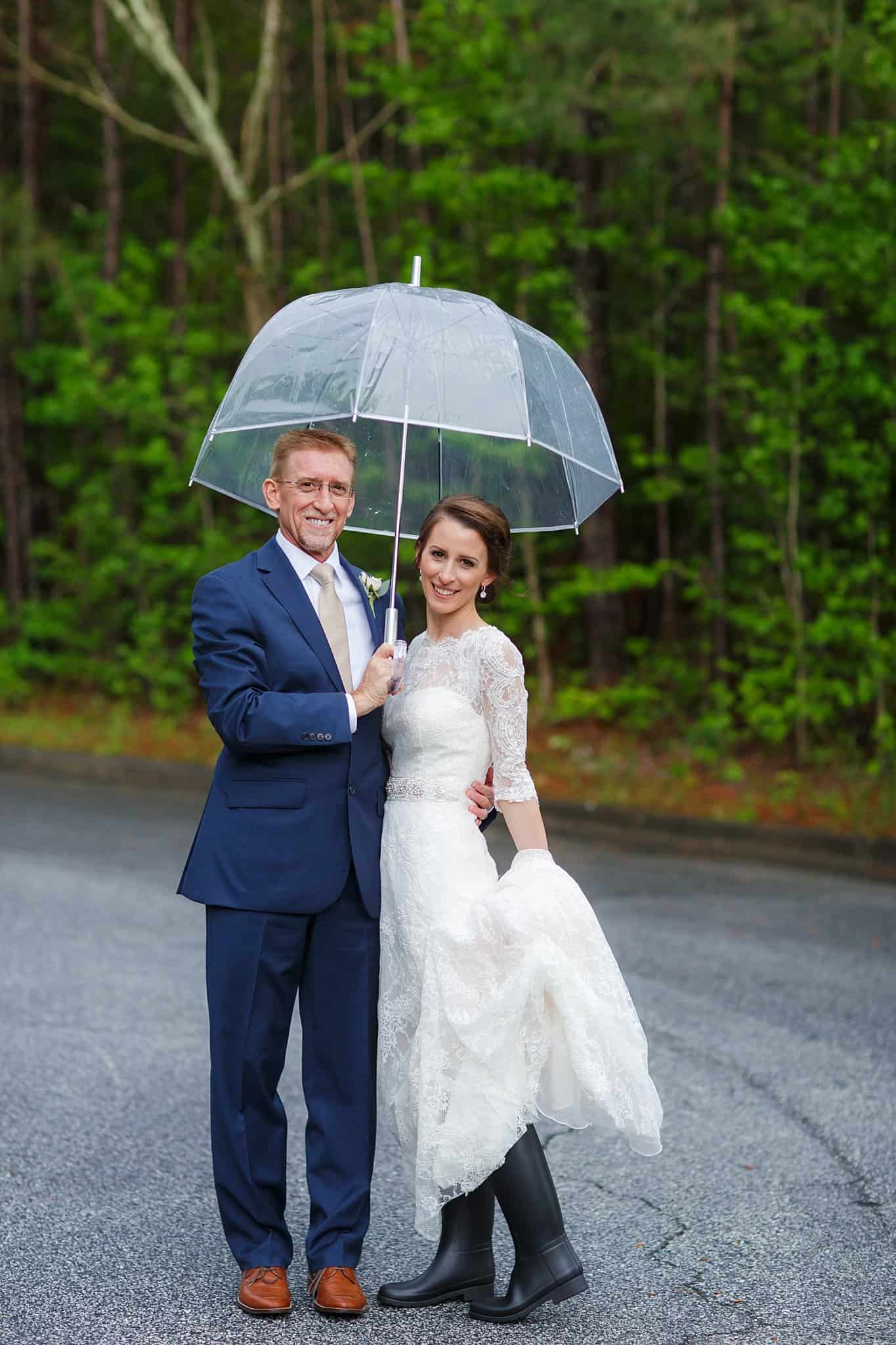 Bride and Groom pose with umbrella