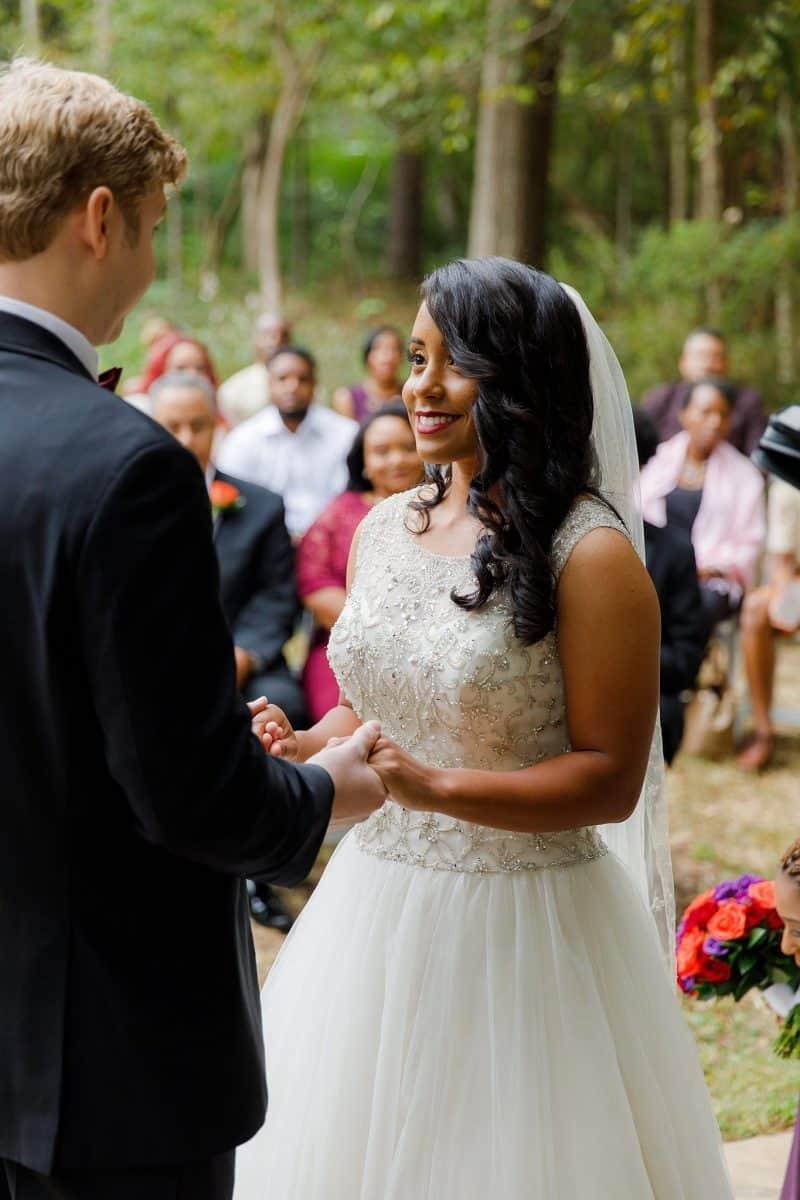 Bride looks into groom's eyes