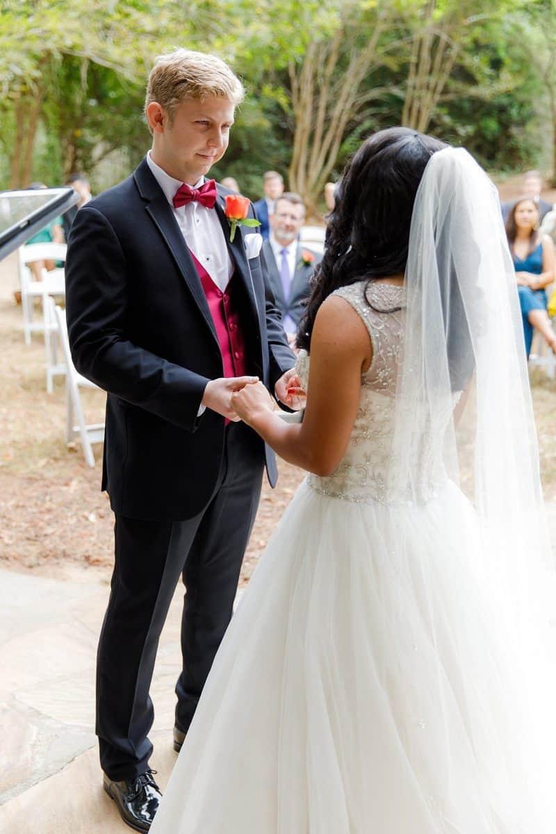 Groom looks into bride's eyes