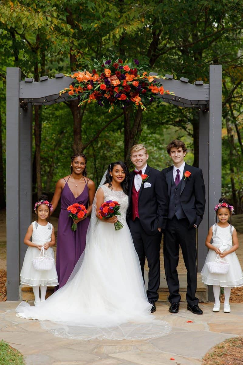Fall bridal party dressed in black and purple