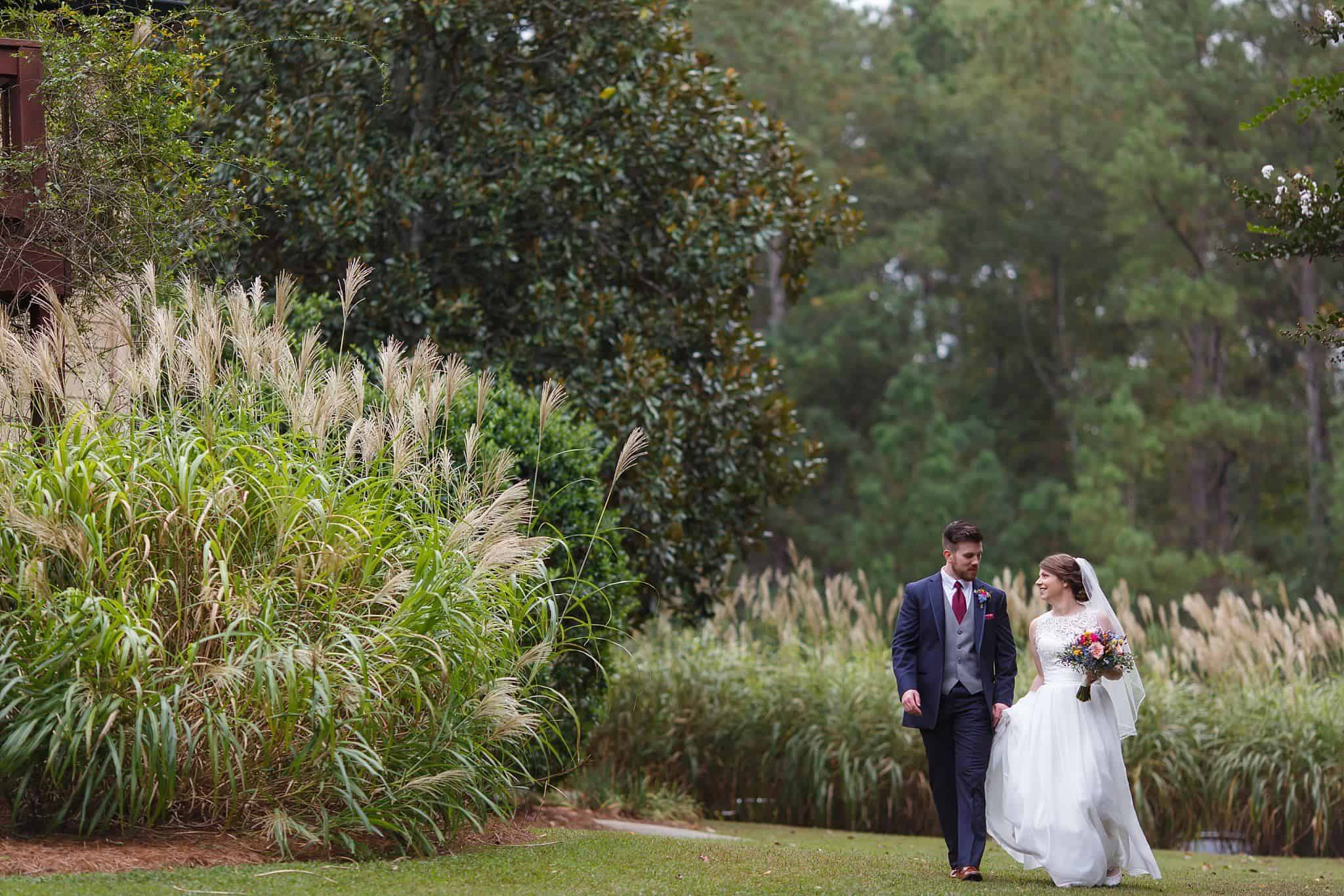 Bride and groom promenade on the lawn